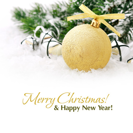 Gold christmas ball and fir branches with decorations on snow photo