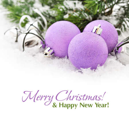 Pink christmas balls and fir branches with decorations on snow photo