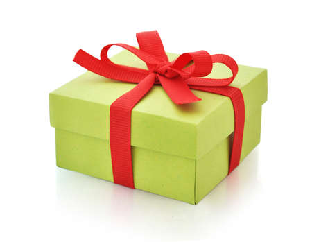 Green gift box with red ribbon isolated on white background.  photo