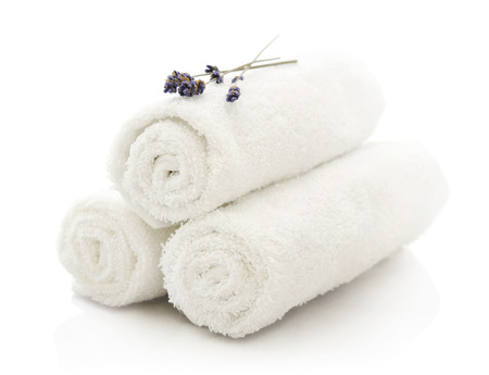White spa towels pile with lavender on white background Banco de Imagens - 23560797