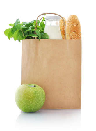 grocery bag: Brown paper bag with food isolated on a white background