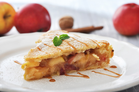 apple pie: Slice of homemade apple pie with fresh apples on wooden background Stock Photo