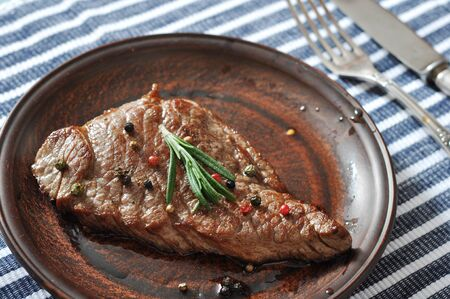 Grilled steak on plate  with spices and rosemary closeup Stock Photo - 23949101