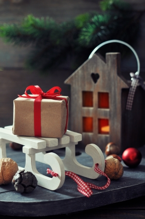 toy box: Christmas decorations with gift box on sled and  lantern on wooden