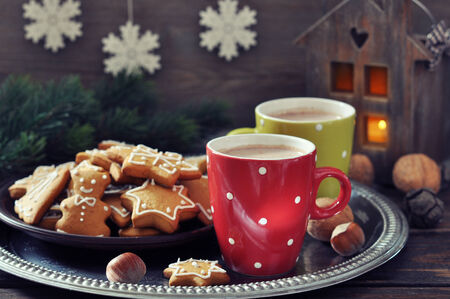 Tray with cups of hot chocolate and ginger biscuits on a wooden  photo