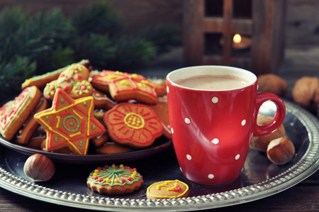 Tray with cup of hot chocolate and ginger biscuits on a wooden  photo