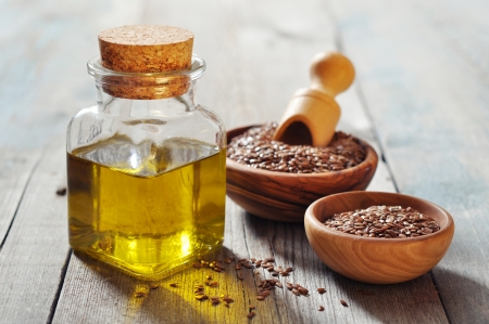 white sesame seeds: Sesame seeds and oil in bottle on wooden background