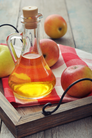 vinegar: Apple cider vinegar in glass bottle and  fresh apples Stock Photo