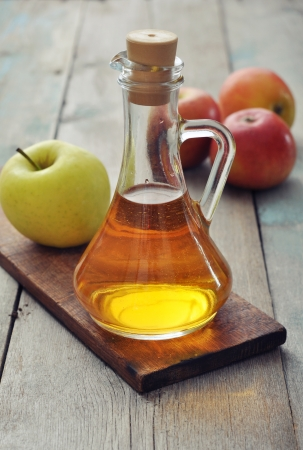 Apple cider vinegar in glass bottle and  fresh apples Stock Photo