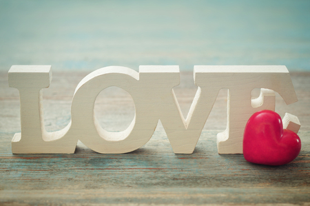 love wallpaper: The word Love with stone heart on a wooden background closeup