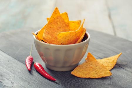 corn tortilla: Corn nachos in bowl on wooden backgrpond
