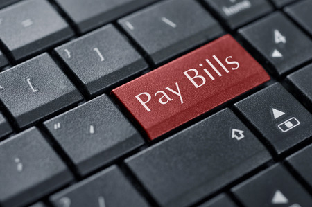 pay bills: Words Pay bills  on button of computer keyboard.