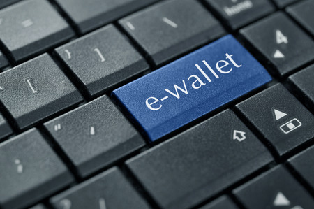 Words e-wallet on button of computer keyboard. photo