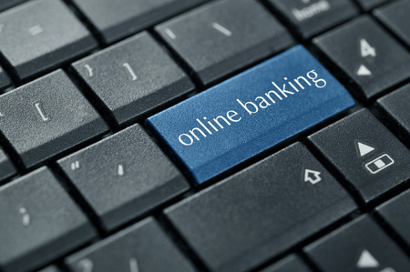banking information: Concept of online banking. Word online banking on button of computer keyboard.