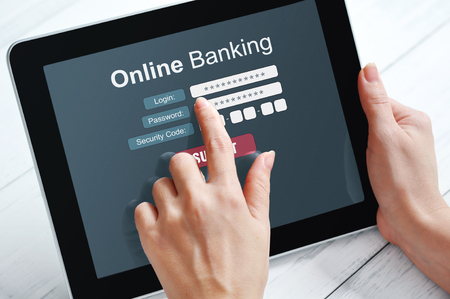 online banking: Female hands using online banking on touch screen device
