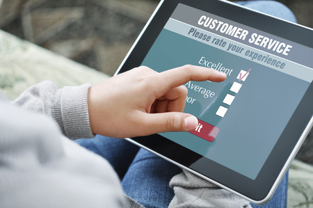 services: Online customer service satisfaction survey on a digital tablet