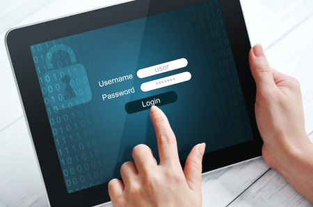 password protection: Female hands using tablet pc protected with password