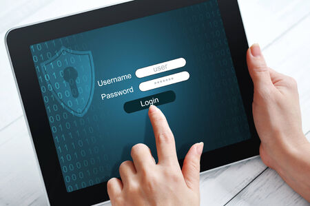 confidentiality: Female hands using tablet pc protected with password