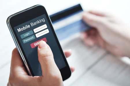mobile security: Female hands using mobile banking on smart phone