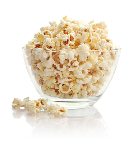 bowl of popcorn: Popcorn in glass bowl  isolated on white background