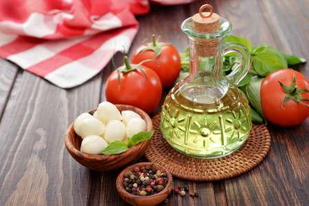 caprese salad: Ingredients for caprese  salad on wooden background