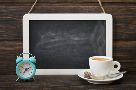 blank slate: Cup of coffee with blackboard and alarm clock on wooden background