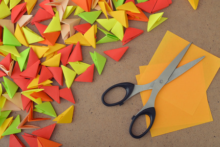 modules: Colorful modules origami on wooden background closeup Stock Photo