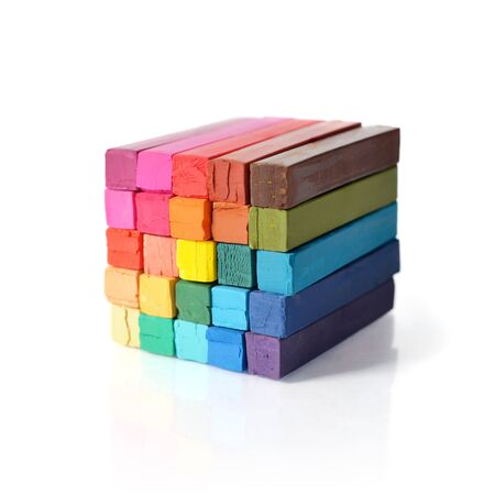 gamut: The cube from multicolored artists pastels isolated on white background