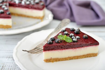 black berry: Black currant cheesecake with fresh berries on plate closeup