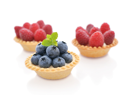 tartlet: Delicious mini tart with fresh blueberry and raspberry isolated on white Stock Photo
