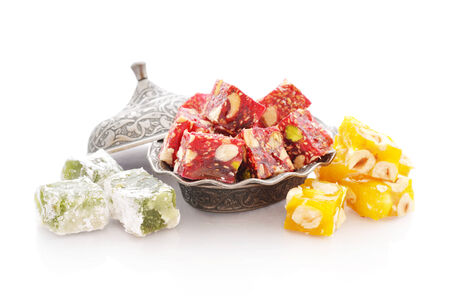 turkish delight: Turkish delight on oriental metal plate isolated on white background