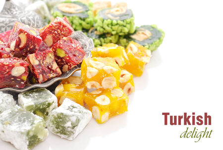 locum: Turkish delight on oriental metal plate isolated on white background
