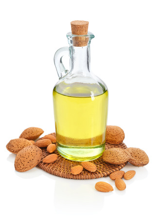 Almonds oil in bottle isolated on white background photo