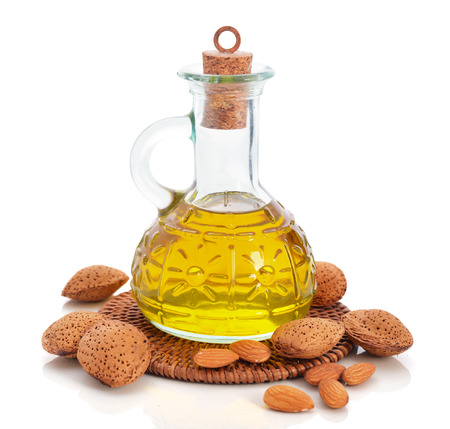 Almond oil in bottle isolated on white background photo