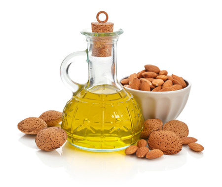 Almonds oil in bottle isolated on white background