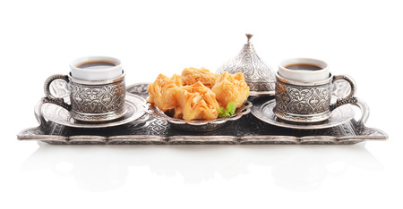 coffee set: Cup of coffee with baklava and metal oriental tray isolated on white background