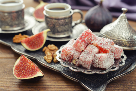 turkish delight: Cup of coffee with turkish delight  and metal oriental tray on wooden background