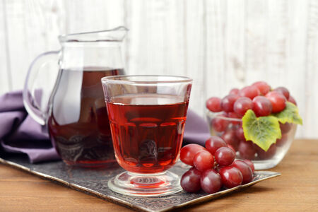 Glass of Grape Juice with fresh berries on the wooden background Stock Photo