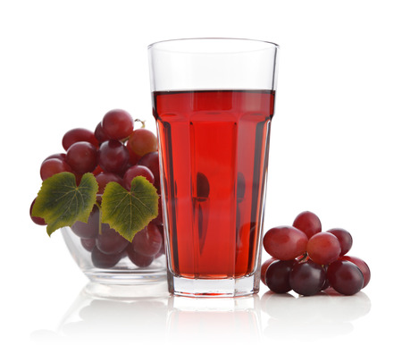 Glass of grape juice isolated on white background Stock Photo
