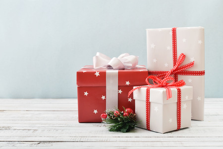 Gift boxes with ribbons and christmas decor on wooden background Фото со стока - 34733272