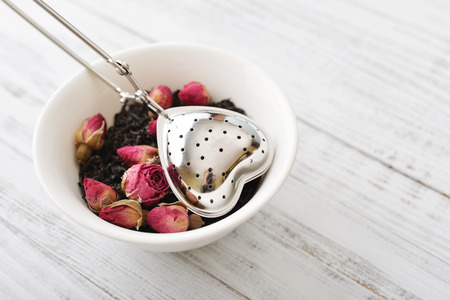 tea strainer: Tea strainer in the shape of heart with dry rose buds