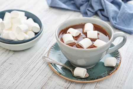 hot beverage: Mug with hot chocolate and marshmallows on wooden table