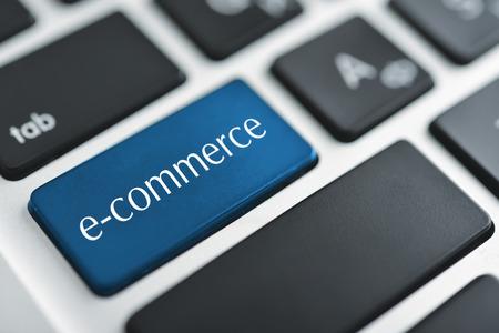 net trade: e-business key on a white keyboard closeup. E-commerce concept image Stock Photo