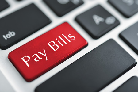pay bill: Words Pay bills on button of computer keyboard.