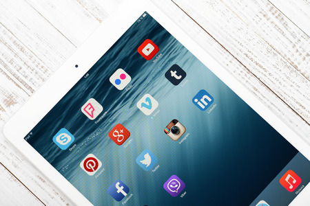 myspace: KIEV, UKRAINE - JANUARY 29, 2015: Social media icons on screen of iPad Air closeup. Social media are most popular tool for communication, sharing information and content between people in internet network.
