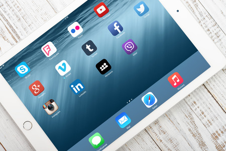 vimeo: KIEV, UKRAINE - JANUARY 29, 2015: Social media icons on screen of iPad Air 2. Social media are most popular tool for communication, sharing information and content between people in internet network.