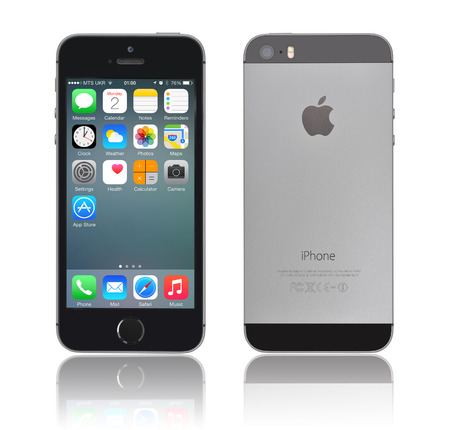 KIEV, UKRAINE - JANUARY 29, 2015: Brand new black Apple iPhone 5s, front and back sides, designed and developed by Apple Inc., it was released on September 20, 2013
