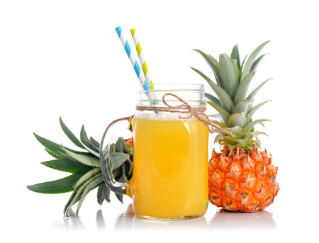 fruits juice: Pineapple juice in glass jar with handle with fresh fruits isolated on white
