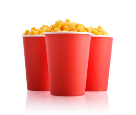 kernels: Boiled corn kernels in red paper cups isolated on white