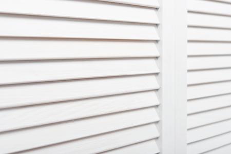 slats: White wooden shutters closeup